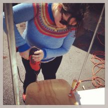 ms Anna working with the drill, making holes for the chair back.