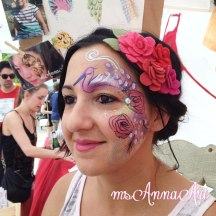 Angel from Mad Love ready to rock her booth with custom face paint by ms Anna